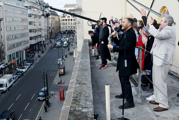 Take That surprises fans with a rooftop performance, joined by cast members of The Band